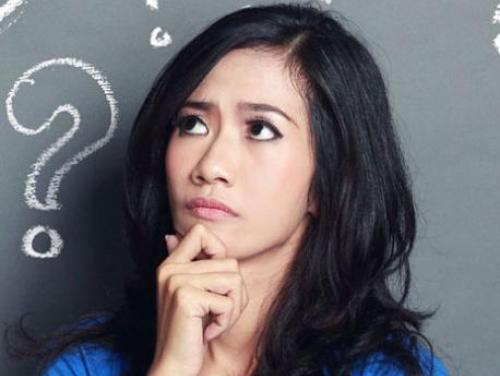 young woman with a puzzled expression and a question mark behind her