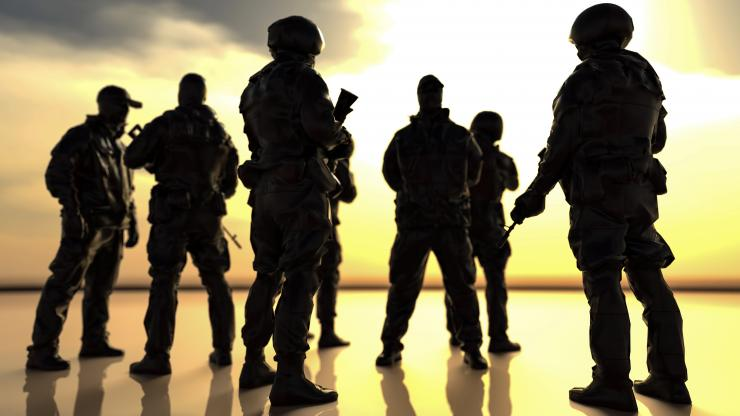 silouette of soldiers in uniform