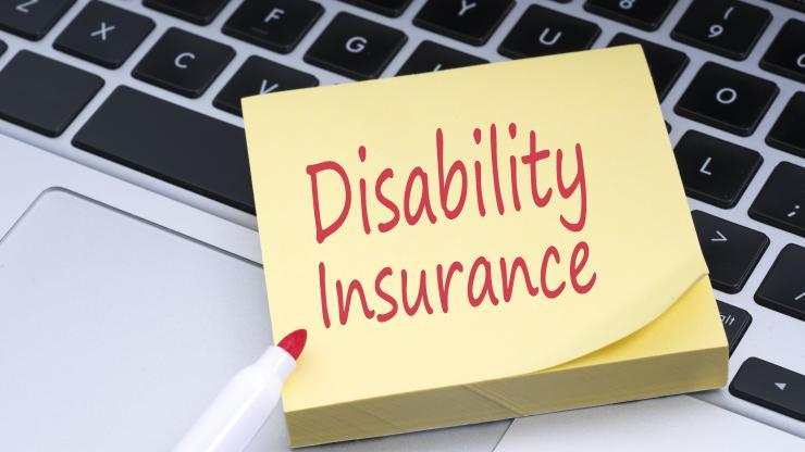 """yellow sticky notepad with """"Disability Insurance"""" written in red"""