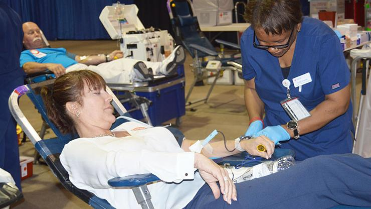 State employee gives blood at health fair