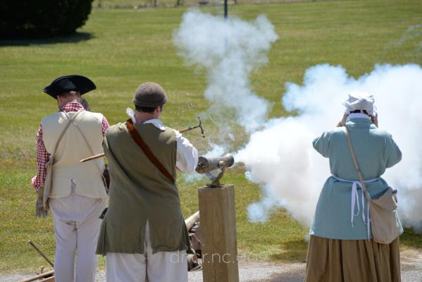 Reenactors firing a cannon