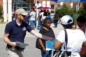 Emergency management staff distributing flyers to people