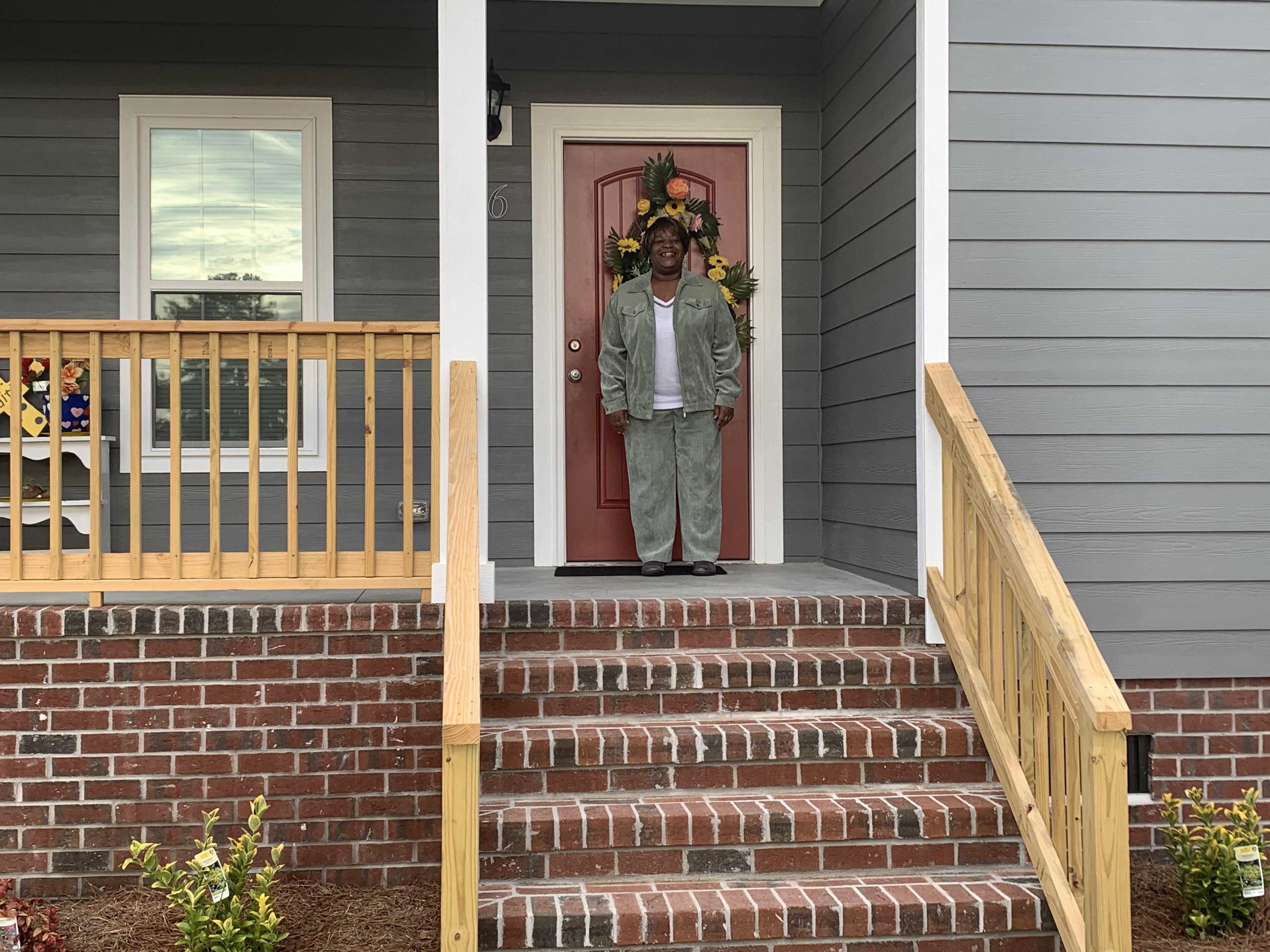 Karine Harris on her front porch