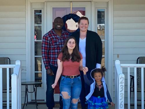 Azeingbe Idehenre with his family on their front porch