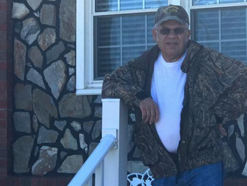 John R. Locklear on his front porch