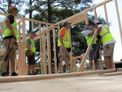 Construction workers framing a home