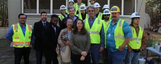 Gov. Roy Cooper joins homeowner Sandra Settle, her daughter and construction crew in Whiteville, NC.