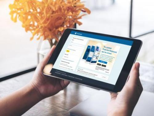 Hands holding tablet with the myNCRetirement statement showing on the screen