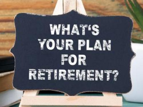 "Chalkboard on easel with words ""What's Your Plan for Retirement?"""
