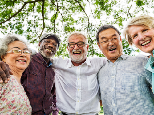 Four senior citizens smiling