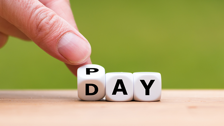 "Letter blocks spelling ""pay day"""