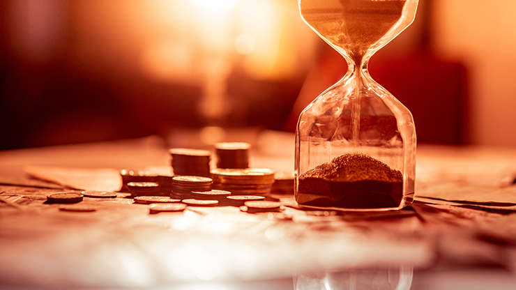 Picture of hourglass and coins