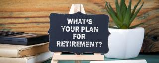 "Chalkboard propped on easel with the words ""What's your plan for retirement?"""