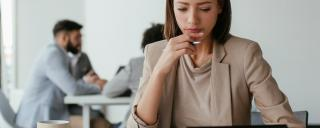 Woman looking at a tablet deep in concentration