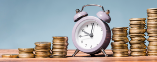 Clock with stacks of coins