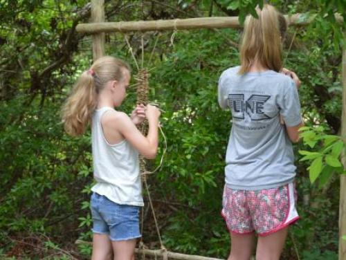 Two girls making rope in American Indian Town at Roanoke Island Festival Park