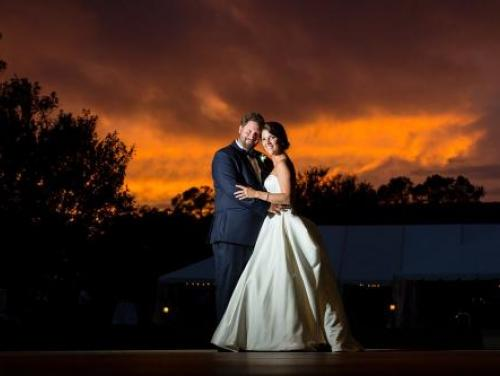Bride and groom, Mallory and Matt, at sunset at during their wedding at Roanoke Island Festival Park