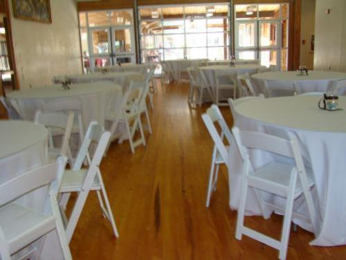 Event set up with tables and chairs in the Grand Mall at Roanoke Island Festival Park