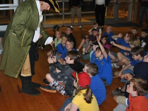 Overnight cub scout group listening to historic interpreter at Roanoke Island Festival Park