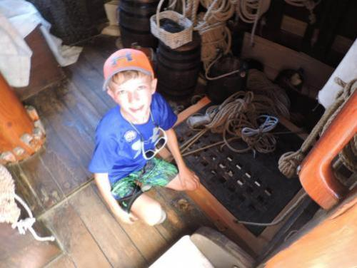 Boy looking for treasure below deck on the Elizabeth II at Roanoke Island Festival Park