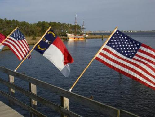 Flags on bridge across from the Elizabeth II on the Manteo waterfront