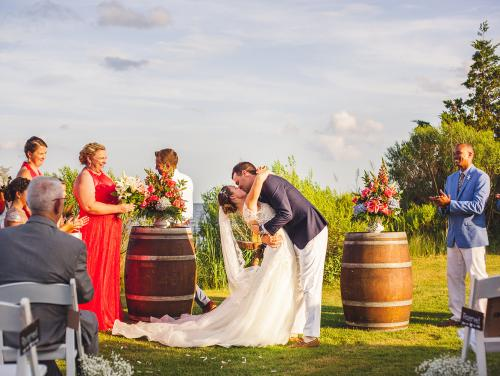 Danielle and Madison's first kiss during their waterfront ceremony at Roanoke Island Festival Park