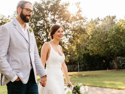 Couple walking outdoors at their wedding at Roanoke Island Festival Park