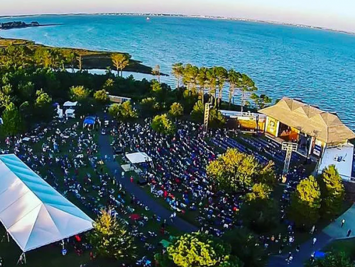 Aerial view of the Outer Banks Bluegrass Festival outside at Roanoke Island Festival Park's waterfront pavilion.
