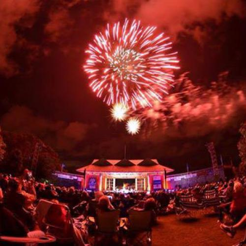 Red fireworks over crowd at the Bluegrass Festival at Roanoke Island Festival Park