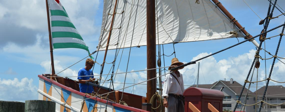 Historic interpreters perform sail drill on the Elizabeth II ship at Roanoke Island Festival Park
