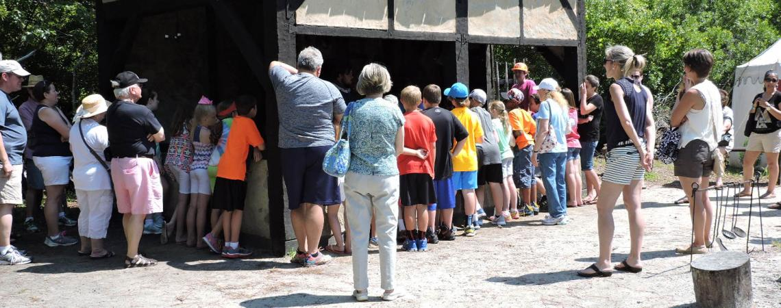 School group tour visiting the blacksmith's shop at Roanoke Island Festival Park