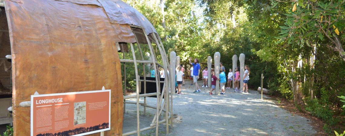 Tour group visiting the dance circle in American Indian Town at Roanoke Island Festival Park