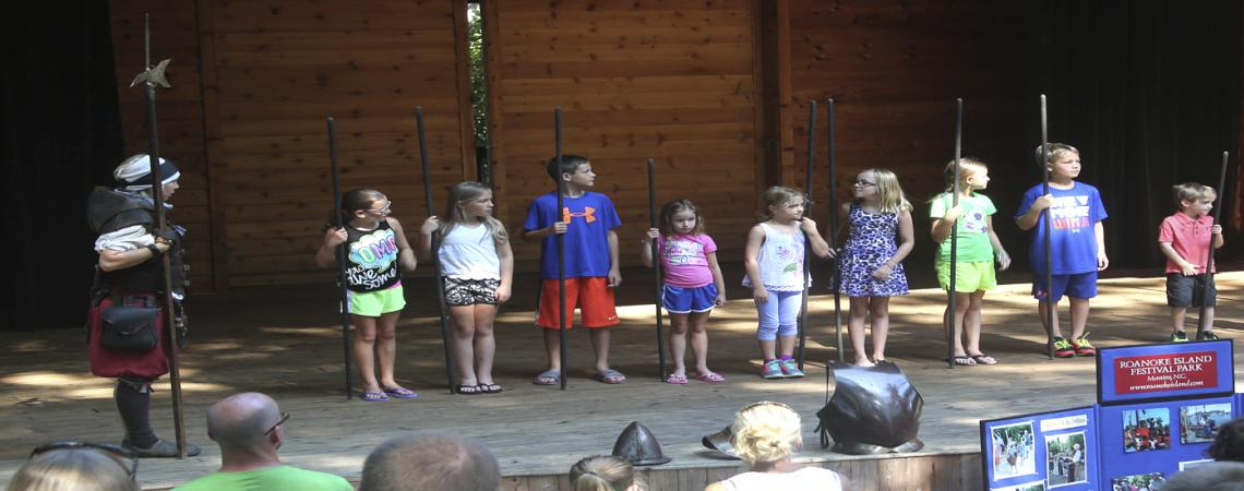 Roanoke Island Festival Park outreach program on the stage with visitors at the Town of Duck stage