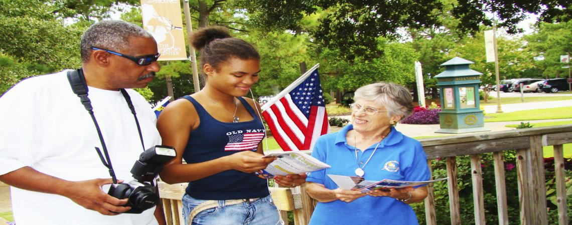 Volunteer greeting guests at Roanoke Island Festival Park