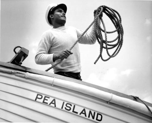 Pea Island surfman, Herbert Collins, casting a line