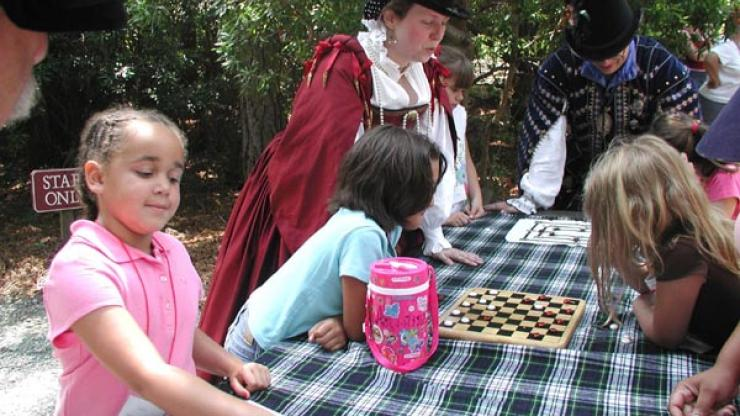 Students playing 16th century games at Roanoke Island Festival Park