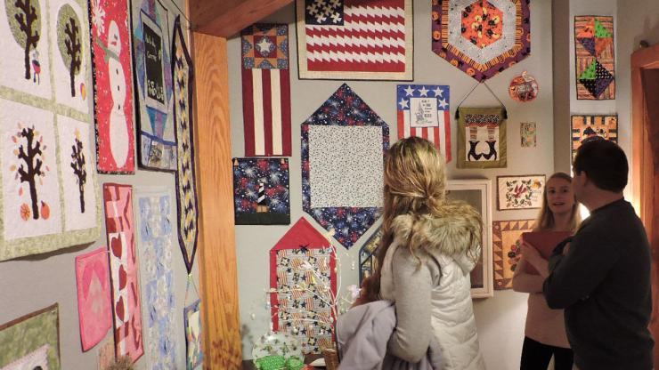 Visitors viewing quilts at the 2018 Outer Banks Community Quilt Show