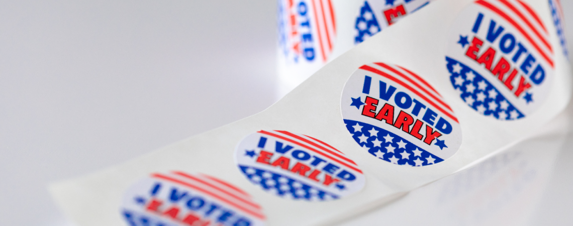 "A roll of stickers that say ""I Voted Early."""