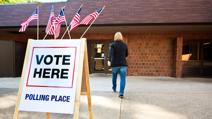 """Sign at polling place that says """"Vote Here."""""""