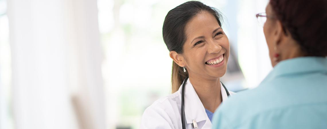 Smiling woman doctor with patient