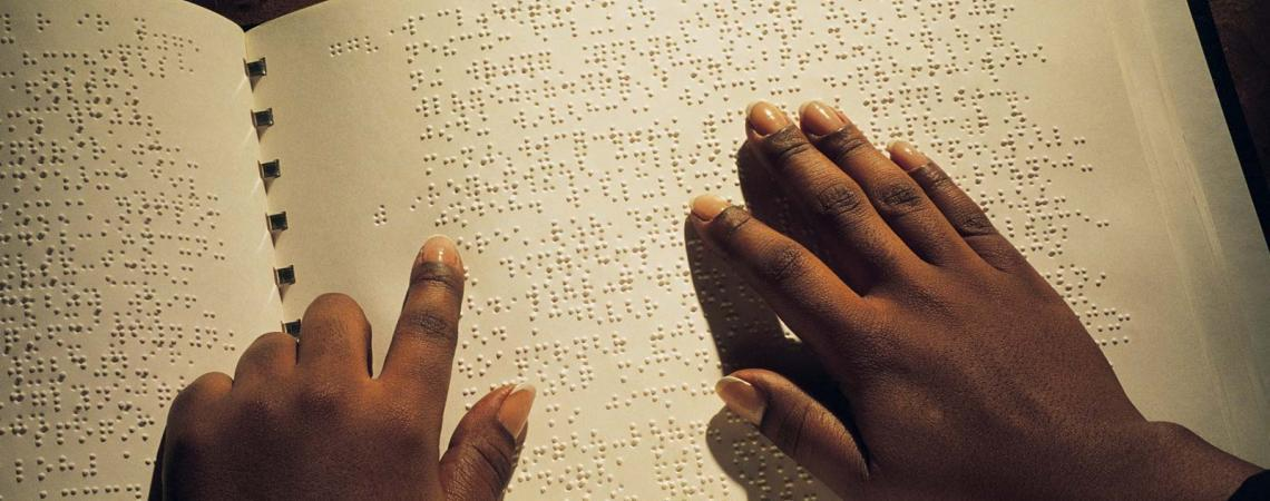 braille book, reading with hands