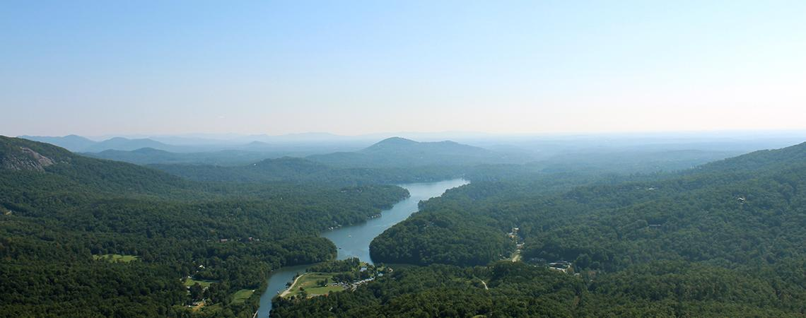 The Chimney Rock at Chimney Rock State Park provides an excellent view of the Hickory Nut Gorge valley, including Lake Lure, below.