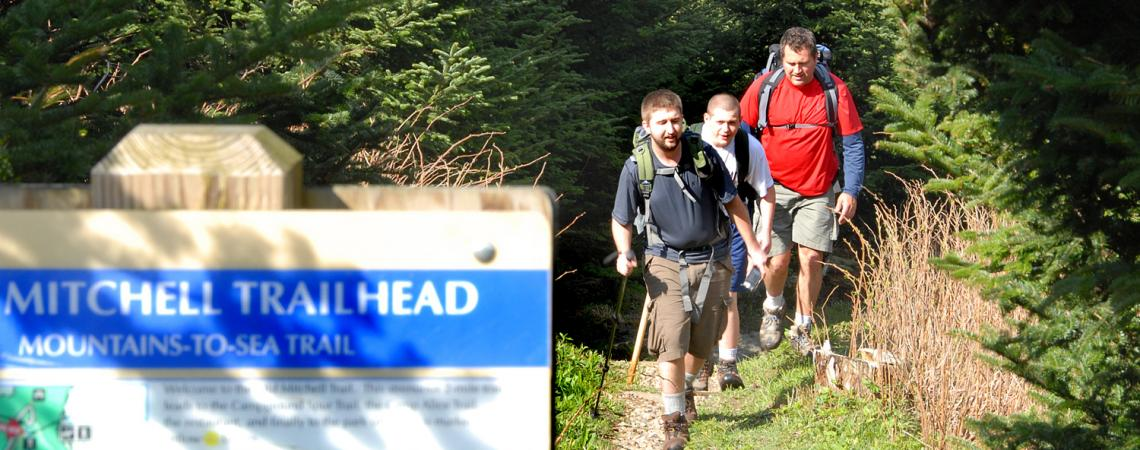 Hikers emerge from the Mountains-to-Sea State Trail at Mount Mitchell State Park.